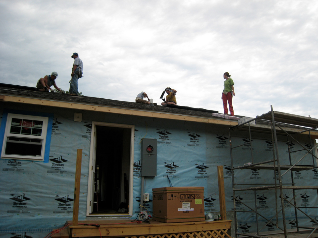 roofers on a roof in kansas city