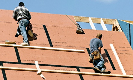 Workers Putting Roof on New Home